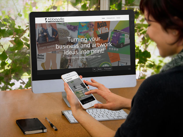 Abbeyville Printing website on a desktop and a mobile device