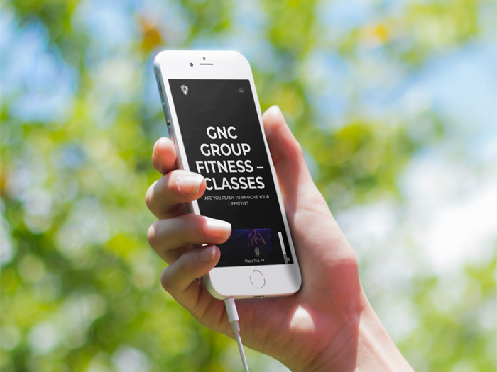 GNC Group Fitness website on a phone