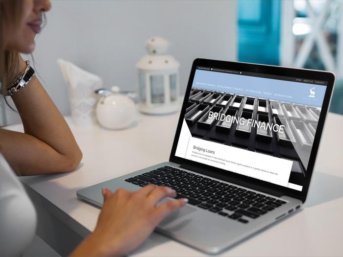 Western Money website on a laptop